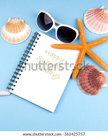 summer background with notebook,starfish and sea shells