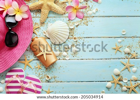 summer background with sunglasses, hat and flip flops on wooden board  - stock photo