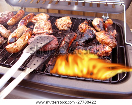 Summer barbecue giving all the flavor of summer - stock photo
