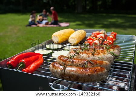 Summer barbecue in the garden with yummy food - stock photo
