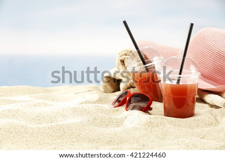 summer beach background of pink hat and juice  - stock photo