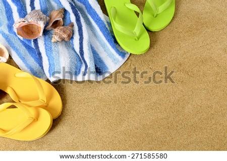 Summer beach background, towel, flip flops, copy space  - stock photo