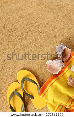 Summer beach background, towel, flip flops.  Copy space, vertical. - stock photo