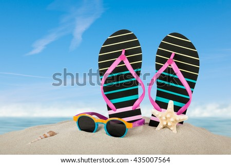 Summer beach background with flip-flop and sunglasses