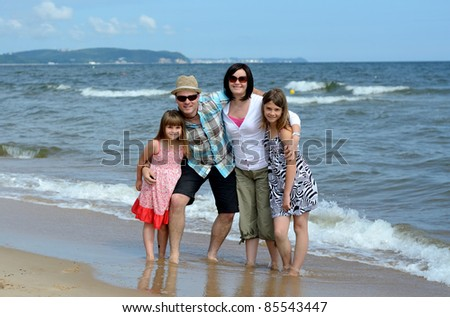 Summer beach family portrait - stock photo