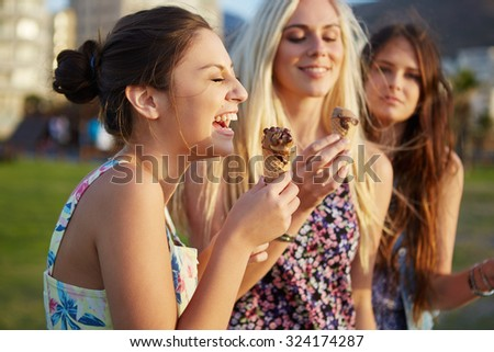 Summer beach ice cream fun laughing teenagers