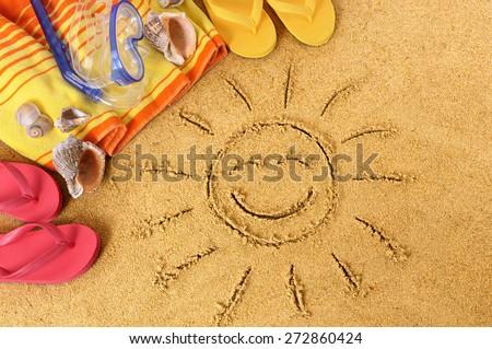 Summer beach smiling face sun, flip flops, towel, top view - stock photo