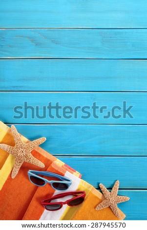Summer beach sunbathing background, sunglasses, copy space, vertical - stock photo