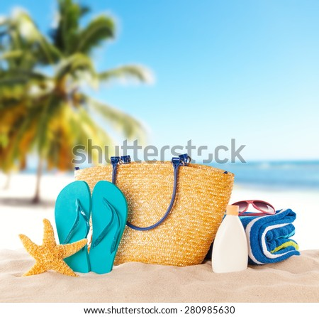 Summer beach with accessories. Blur azure sea on background - stock photo