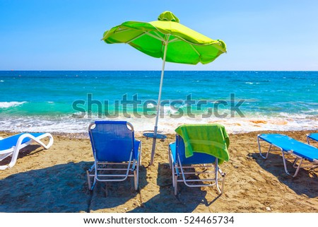 Summer beach with sun beds and umbrella. Cyprus.