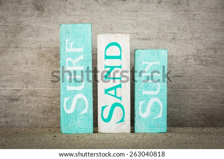 Summer beach wood blocks decoration - stock photo