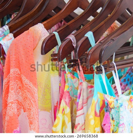 Summer beautiful clothes hanging in the store - stock photo
