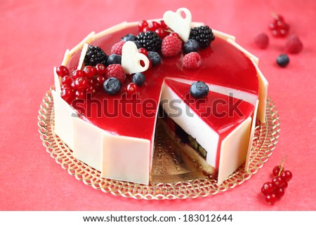 Summer Berries Cake with Coconut Mousse, on a red background  - stock photo