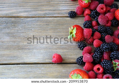 Summer berries on wooden background food closeup - stock photo