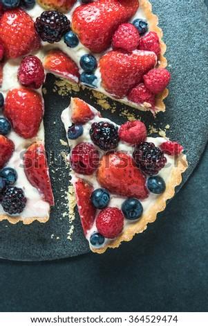 Summer berries tasty tart, from overhead - stock photo