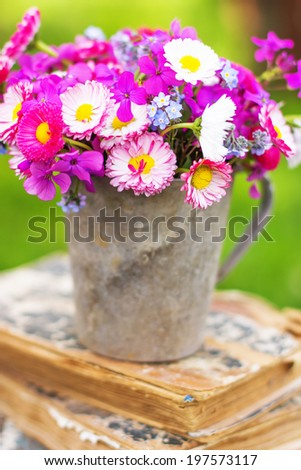 Summer bouquet of garden pink and white daisy on rustic table outdoor