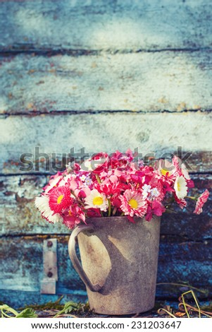 Summer bouquet of garden pink and white daisy on rustic wooden background