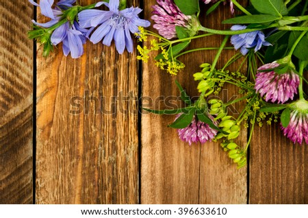 Summer bouquet of Meadow flowers on a wooden background. - stock photo