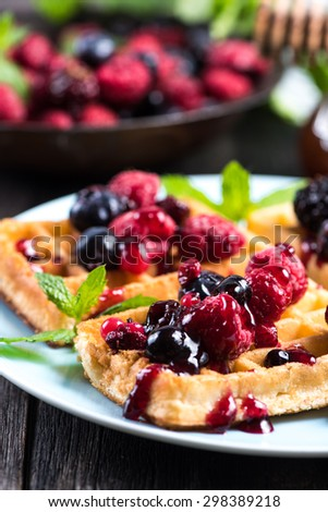 summer breakfast, belgian waffles with fresh fruits and honey