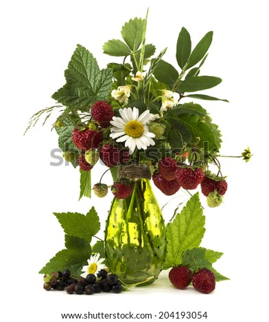 Summer bunch of flowers and berries in glass vase isolated on white - stock photo