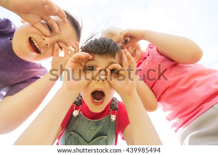summer, childhood, leisure and people concept - group of happy kids having fun and making faces outdoors - stock photo