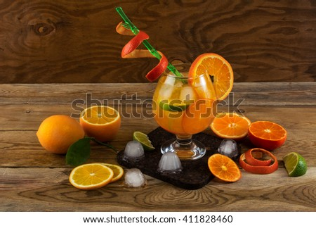 Summer citrus cocktail on wooden table. Fruit cocktail. Fruit drink. Citrus lemonade. Fruit lemonade. Summer drink  - stock photo