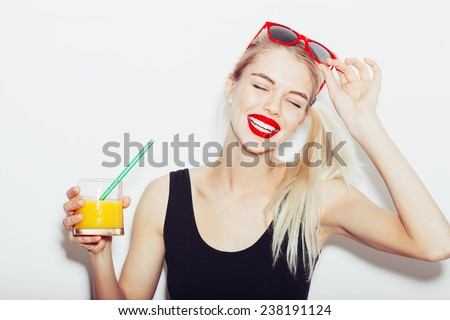Summer closeup portrait of pretty smiling blonde woman in sunglasses with cocktail - stock photo