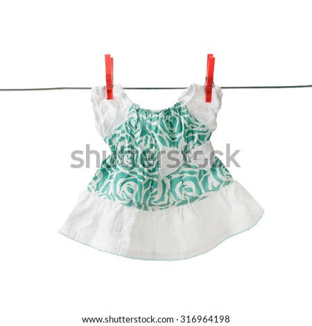 summer clothes for a little girl isolated on white