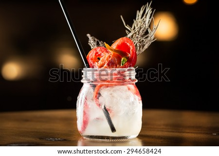 Summer cocktail in a glass pot. - stock photo