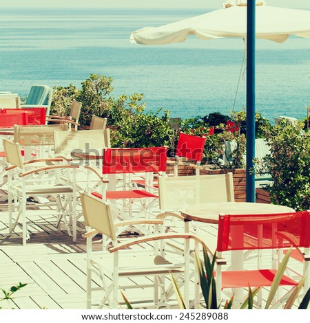 Summer coffee shop by the sea, impressions of Greece - stock photo