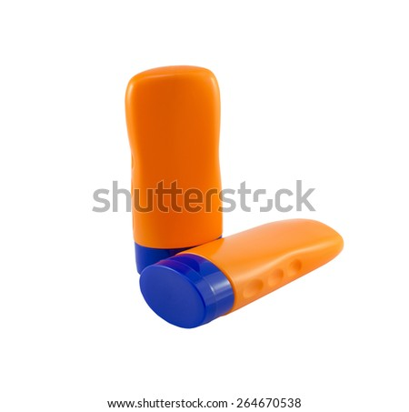 Summer concept : Beach items - Bottles with sunblock lotion - stock photo