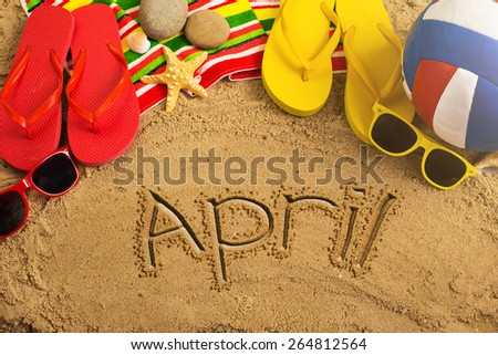 Summer concept of sandy beach, colorful thongs shoes, sunglasses, ball and inscription - stock photo