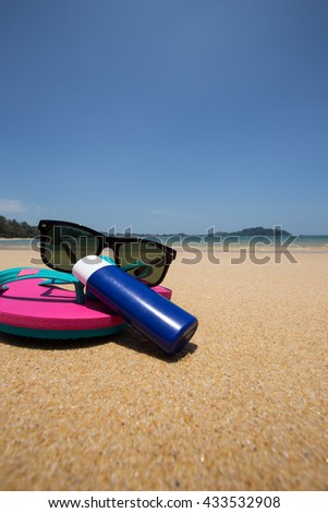 Summer concept - Sailing ship model, Sunglasses and pink sandals. - stock photo