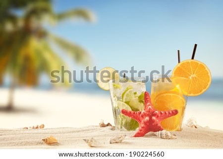 Summer concept with exotic drinks, starfish and accessories. - stock photo