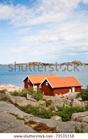 Summer cottages at the Swedish west coast - stock photo