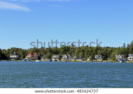 Summer cottages create an inviting skyline on Northern Michigan's Crooked Lake, near Petoskey.