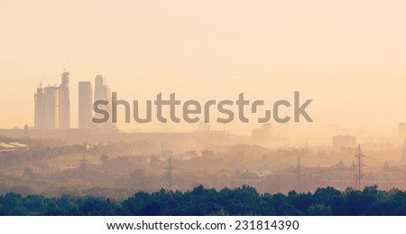 summer dawn and the view of the skyscrapers of Moscow City and the Stalinist high-rise buildings