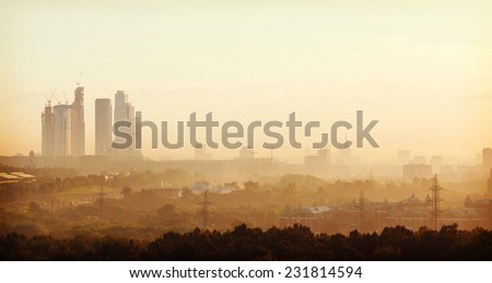 summer dawn and the view of the skyscrapers of Moscow City and the Stalinist high-rise buildings - stock photo