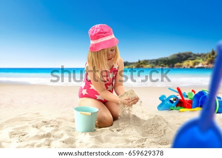 Summer day on beach and young girl on sand