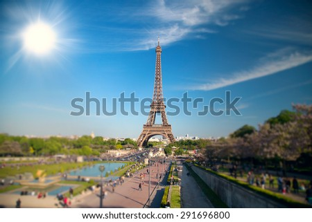 summer day the sun shines over the Eiffel Tower symbol of Paris. Travel to Europe and France - stock photo