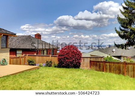 Summer day view from the back yard of Seattle and Space Needle.