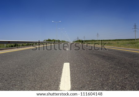 summer deserted road. - stock photo