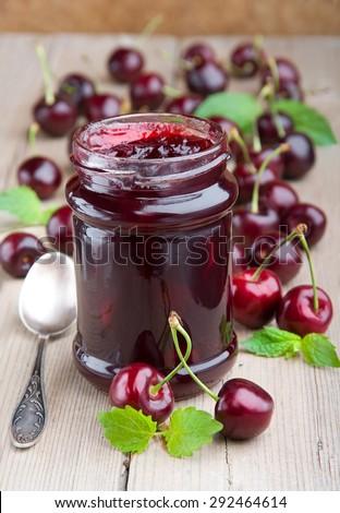 Summer dessert. Fresh sweet cherry and sweet cherry jam. - stock photo