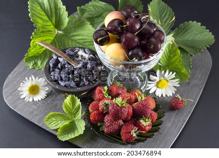 Summer dessert with fruits and berries in assortment - stock photo