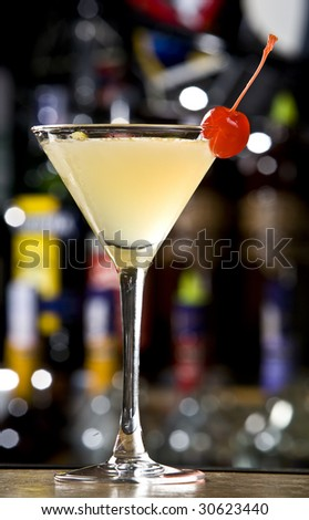 Summer drink decorated with a slice cherry - stock photo