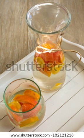 Summer drink fresh fruit water with citrus - stock photo