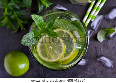 summer drink , mojito cocktail with mint and lime on black background, top view - stock photo