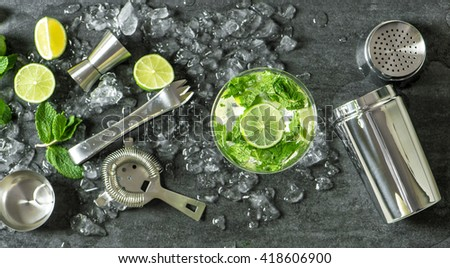 Summer drink mojito with lime, mint and ice. Top view. Glass of cocktail. Cocktail drink. Cold drink. Summer drink - stock photo
