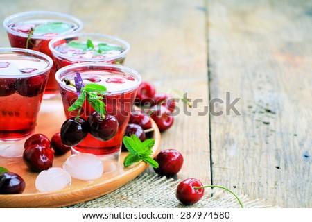summer drink with cherries and ripe cherries, organic food - stock photo