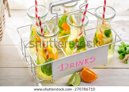 Summer drink with citrus fruits